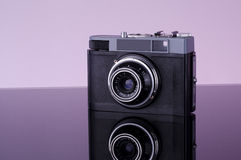 Old camera. Wiht reflected background stock image