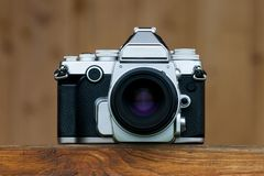 Old camera on wooden. Floor vintage style stock photos