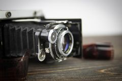 Old camera on the wooden table Royalty Free Stock Images