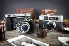 Old camera on the wooden table Royalty Free Stock Image