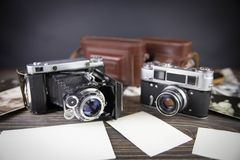 Old camera on the wooden table Stock Photo