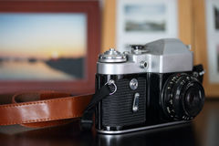 Old camera on wooden table Royalty Free Stock Photo