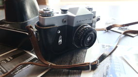 Old camera on a wooden table stock video footage