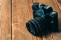 Old camera and on wooden table Royalty Free Stock Photos