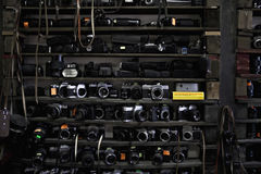 Old cameras and lenses Royalty Free Stock Photos