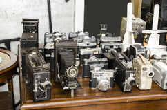 Old cameras. On table Royalty Free Stock Photos