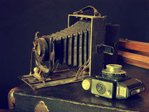 Old cameras, tripod and bag Royalty Free Stock Images