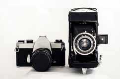 Old Cameras. On withe background Royalty Free Stock Images