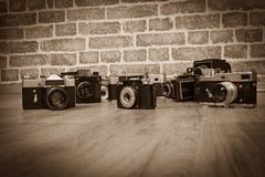 Old cameras on a wood royalty free stock images