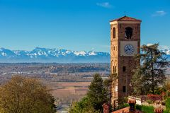 Old campanile and autumnal landscape view in Italy. Stock Photos