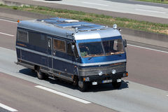 Old camper van on the highway in Germany Stock Image