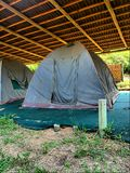 Old camping tent under roof Royalty Free Stock Images
