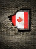 Old Canada flag in brick wall. 3d rendering of a Canada flag over a rusty metallic plate embebed on an old brick wall Royalty Free Stock Photos