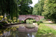 Old canal bridge. An old 17th century red brick bridge built over a canal stock photo