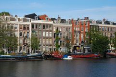 Old Canal Houses in Amsterdam at the water royalty free stock photos