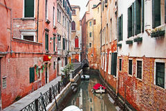 Old canal surrounded by historic buildings in Venice, Italy Stock Image