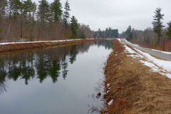 Old canal on a winter day. The Cumberland and Oxford Canal was opened in 1832 to connect the largest lakes of southern Maine with the seaport of Portland, Maine stock photos