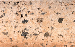 Old Canarian house wall. Detail shot of an old Canarian house wall with brown plaster, taken on Fuerteventura, Canary Islands, Spain royalty free stock images