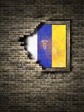 Old Canary islands flag in brick wall. 3d rendering of a Canary islands Spanish Community flag over a rusty metallic plate embedded on an old brick wall Stock Images