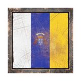 Old Canary islands flag. 3d rendering of a Canary islands Community flag over a rusty metallic plate wit a rusty frame. Isolated on white background Royalty Free Stock Image