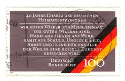 Old canceled german stamp with flag Royalty Free Stock Photography