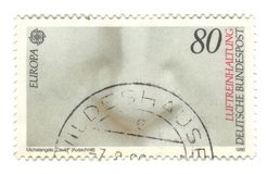 Old canceled german stamp with Michelangelo statue. Detail Stock Image