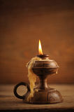Old candle. On a wooden table royalty free stock photography