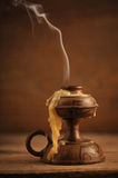 Old candle. On a wooden table royalty free stock photos