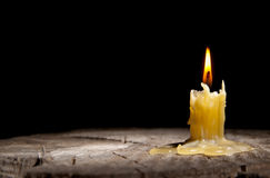 Old candle on the black background Stock Photography
