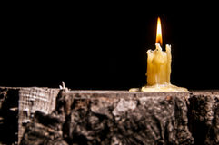 Old candle on the black background Royalty Free Stock Photos