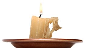 Old candle isolated on white background Royalty Free Stock Image