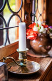 Old candleholder. Old candelholder at a window Stock Photos