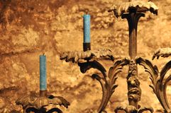 Old candlestick with blue candles Royalty Free Stock Image