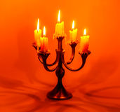 Old candlestick with burning candles stock image