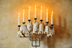 Old candlestick with burning candles stock images