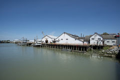 Old cannery along a pier Royalty Free Stock Images
