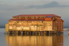 Old Cannery Building, Astoria, Oregon. Photo of an old cannery building in Astoria, Oregon at sunset stock images