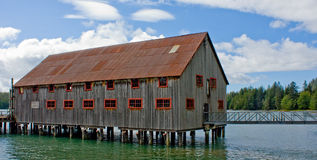 Old Cannery Building on Stilts. An old cannery net loft built on stilts at the edge of the ocean in Port Edward, British Columbia, Canada Stock Photo