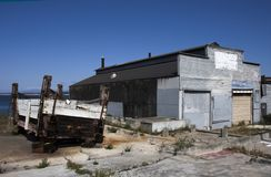 Old Cannery and Fish Hopper on Broken Concrete on California Coast stock image