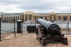 A cannon at the Thames river. Butlers Wharf, London. Stock Photography
