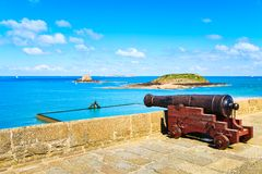Old cannon along Saint Malo wall ramparts and fort Royalty Free Stock Images