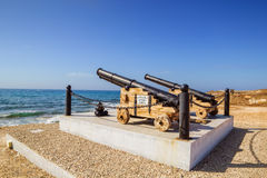 Old cannon ball guns. Monument by the Paphos castle on the sea shore, Cyprus Royalty Free Stock Photography