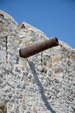 Old cannon barrel on defensive wall Royalty Free Stock Image