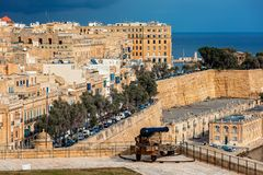 Old cannon on bastion and Valletta city on background stock photos