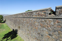 Old cannon behind the fortress wall in Colonia del Sacramento Stock Photos