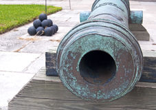 Old cannon and cannonballs Stock Photo