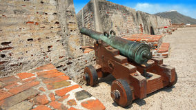 Old cannon in Castillo San Felipe de Barajas with the Convent of La Popa in the background Stock Images