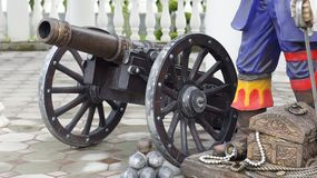 Old cannon. A copy of an old cannon with cores in the style of the times of colonization of the New World and the era of pirates, standing in the resort tourist royalty free stock images
