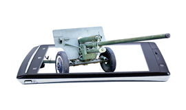 Old cannon on display smartphone. Collage Royalty Free Stock Photos