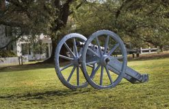 Old cannon in field Stock Photo